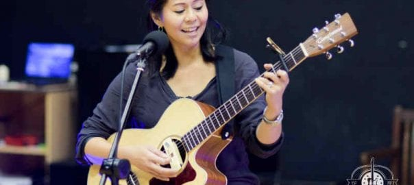 rhona our guitar student performing guitar