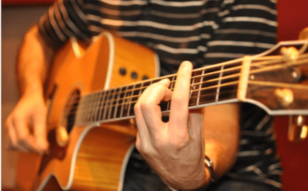 playing barre chords on guitar