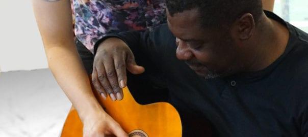 Guitar student with teacher