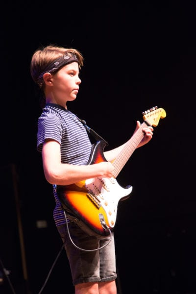 performing electric guitar