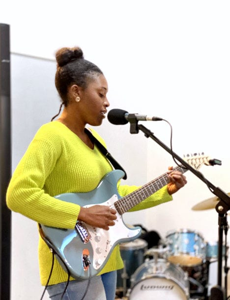 chardelle playing electric guitar guitar tuition east london