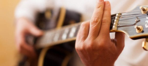 beginners learning to play barre chords