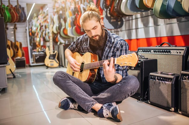 visiting guitar store to buy guitar