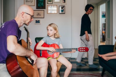 how to help your child play guitar at home