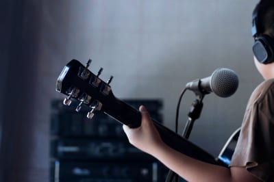 record child playing guitar